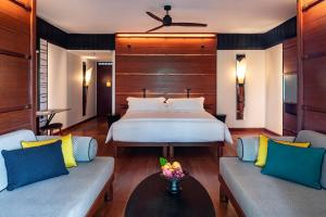 A bed or beds in a room at The Datai Langkawi