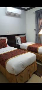 Cama ou camas em um quarto em Natwan Furnished unites