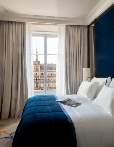 A bed or beds in a room at Pestana Plaza Mayor Madrid
