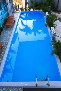 A view of the pool at Homestay cantho river or nearby