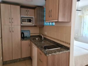 Ett kök eller pentry på Apartamentos El Barrio