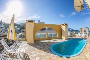 The swimming pool at or close to Bombinhas Praia Apart Hotel - unidade rua Bem Te Vi