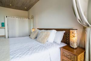 A bed or beds in a room at La Pedrera Small Hotel & Spa