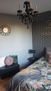 A bed or beds in a room at Pokoje Gościnne Zblewo