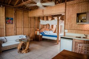 A bed or beds in a room at Magic Reef Bungalows