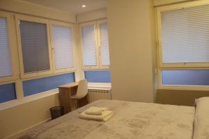A bed or beds in a room at Alojamientos Acella