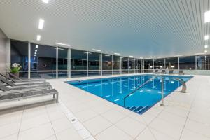 Der Swimmingpool an oder in der Nähe von Grand Hôtel des Rasses