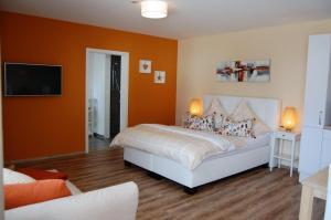 Ein Bett oder Betten in einem Zimmer der Unterkunft Dillinger Schwabennest