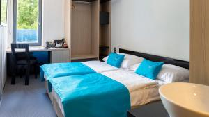 A bed or beds in a room at Hotel AquaCity Riverside