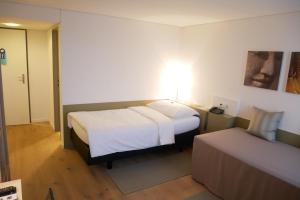 Кровать или кровати в номере Hotel Schwanen Wil