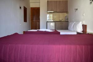 Letto o letti in una camera di Michalis Place Apartments