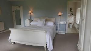 A bed or beds in a room at Belmount Hall