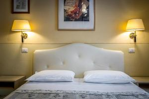 Letto o letti in una camera di Cimarosa Harmony
