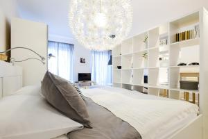 A bed or beds in a room at Apartments Bastova, Stela & Mia Apartments