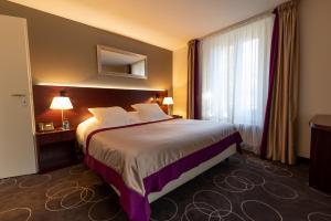 Letto o letti in una camera di Grand Hotel des Bains