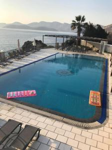 The swimming pool at or close to ELENA APARTMENTS