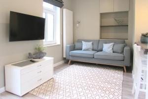 Ein Sitzbereich in der Unterkunft Gästehaus Muhl