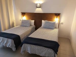 Cama o camas de una habitación en L'Hostalet de Canet