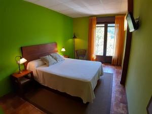 Cama o camas de una habitación en Hotel Rural Los Molinillos