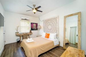 A bed or beds in a room at Treehouse Studio Hotel