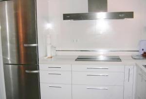 Una cocina o zona de cocina en Casa Rectoral de Belesar