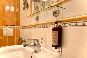 Ванная комната в Hotel Abácie & Wellness