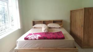 A bed or beds in a room at Sekar Gambir Homestay