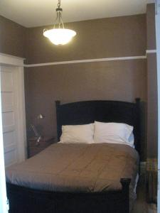 A bed or beds in a room at The Westland Suite