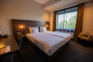 A bed or beds in a room at Best Western Plus Hotel Groningen Plaza