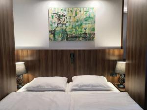 Łóżko lub łóżka w pokoju w obiekcie Atelier Hotel