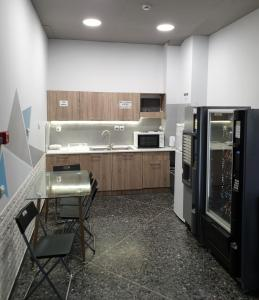 A kitchen or kitchenette at Crafoord Place Hostel Athens