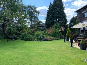 A garden outside Dimple Well Lodge Hotel