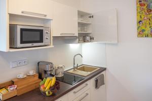 Kuchyň nebo kuchyňský kout v ubytování Apartmán Calma