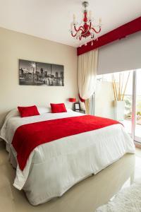 Una cama o camas en una habitación de Hotel Master Suite Devoto