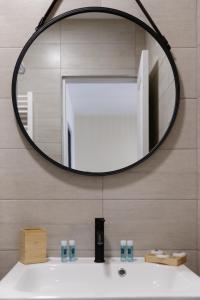 A bathroom at Royal Vieux-Port - Climatisé