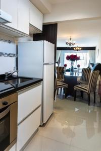 Una cocina o kitchenette en Hotel Master Suite Devoto