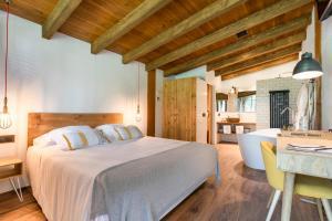 Un ou plusieurs lits dans un hébergement de l'établissement Hotel Mas la Ferreria