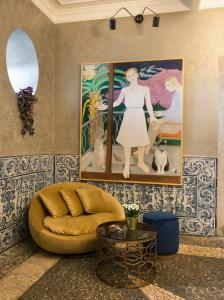 A seating area at Casa dell'Arte Club House