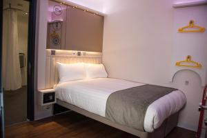 A bed or beds in a room at Point A Hotel London Westminster