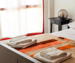 A bed or beds in a room at BUENAVIDA