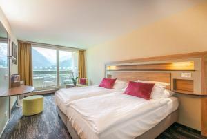 Cama o camas de una habitación en Metropole Swiss Quality Hotel