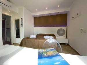 Ein Bett oder Betten in einem Zimmer der Unterkunft 'A Alera Room & Breakfast