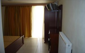 Μια τηλεόραση ή/και κέντρο ψυχαγωγίας στο Hotel Niko Paradise