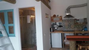 A cozinha ou cozinha compacta de PuraVida Divehouse