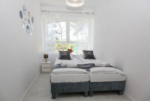Postel nebo postele na pokoji v ubytování Apartamenty Gdańsk EU - Baltica Towers - Wakacyjny
