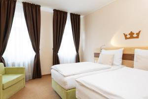 A bed or beds in a room at Hotel Česká Koruna