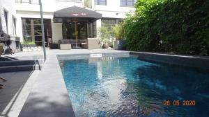 The swimming pool at or near B&B Eleven