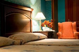 Cama o camas de una habitación en Hotel Casona Los Caballeros