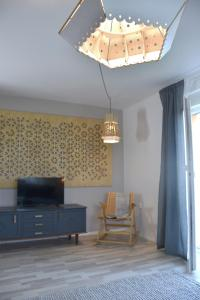 A television and/or entertainment center at Lesnavesna designer Apartment with a garden