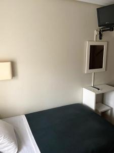 A television and/or entertainment center at Hotel Ovetense